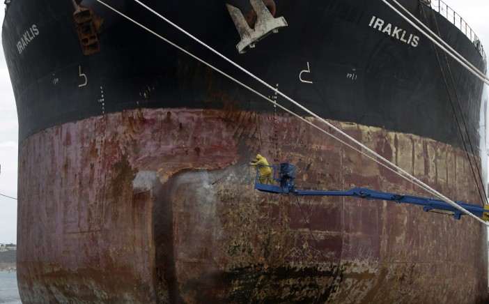 epaselect epa04774010 A worker remove rust from a ship using a water jet at the shipyard of Perama, near Athens, Greece 29 May 2015. There has been a sudden, positive change in the Brussels Group, during the final stretch in efforts to achieve an agreement between the Greek government and its partners, a source in Brussels reported on 29 May 2015. According to the source, there were only 'very few elements left' on which a substantive solution had yet to be found, so that an agreement can be reached.  EPA/YANNIS KOLESIDIS