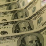Dollar firms, higher yields support as markets ponder Fed outlook