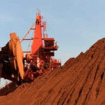 Dalian iron ore pulls back from 3-yr high as steel steadies