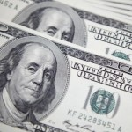 Dollar edges lower on continued bets on dovish Fed