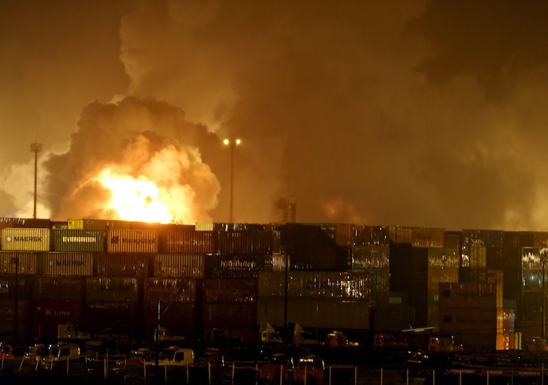 Fire rises from chemical containers from logistic company Localfrio in Guaruja, Brazil, January 14, 2016. Up to a dozen containers carrying chemicals caught fire at a terminal at Brazil's largest port of Santos on Thursday, restricting ship movement, representatives of the port authority Codesp said. REUTERS/Paulo Whitaker