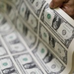 Dollar holds steady as low U.S. yields offset solid data
