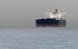 "Malta-flagged Iranian crude oil supertanker ""Delvar"" is seen anchored off Singapore in this March 1, 2012 file photo. The United States expects countries that buy oil from Iran to further reduce their purchases if they want to avoid U.S. sanctions, a State Department source said on December 5, 2012.  REUTERS/Tim Chong (SINGAPORE - Tags: BUSINESS POLITICS ENERGY MARITIME)"
