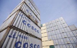 "Containers from China Ocean Shipping Company (COSCO) are pictured at a port in Shanghai, China, in this February 17, 2016 file photo. REUTERS/Aly Song/Files     GLOBAL BUSINESS WEEK AHEAD PACKAGE - SEARCH ""BUSINESS WEEK AHEAD MARCH 28"" FOR ALL IMAGES"