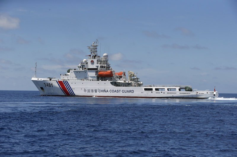 A Chinese Coast Guard vessel is pictured on the disputed Second Thomas Shoal, part of the Spratly Islands, in the South China Sea March 29, 2014. Picture taken March 29, 2014.  REUTERS/Erik De Castro