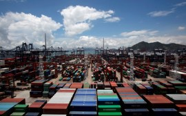 Containers are piled up at Kwai Chung Container Terminals in Hong Kong July 6, 2012. REUTERS/Bobby Yip