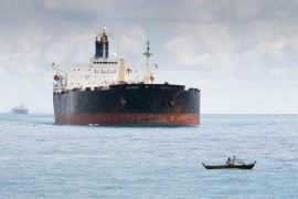 Tanker and small boat