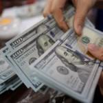 Dollar gains as data shows growing U.S. economy