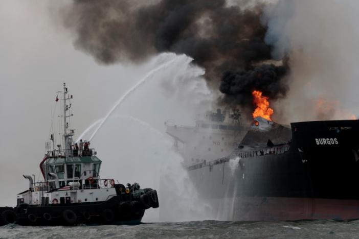 "Firefighters extinguish a fire on an oil tanker of Mexican state oil company Pemex named ""Burgos"" off the coast of Boca del Rio in Veracruz state, Mexico September 24, 2016. REUTERS/Victor Yanez"