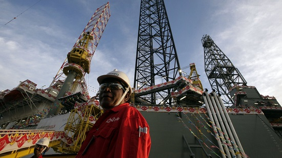 SEADRILL 3 oil rig is seen during its christening ceremony in Singapore...The SEADRILL 3, the first of four oil rigs that Keppel FELS is building for the same customer, is seen during its christening ceremony in Singapore April 21, 2006. Upon its delivery in May 2006, SEADRILL 3 will be deployed to TOTAL in Nigeria for two years. It will be capable of operating in 350 feet water depth, drilling down to 30,000 feet and accommodating 110 men. REUTERS/Luis Enrique Ascui