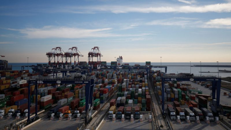 Containers are seen next to cargo boat at Barcelona's Port, Spain, January 24, 2017. Picture taken January 24, 2017. REUTERS/Albert Gea