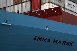 A crew member is seen on board Emma Maersk, one of the world's largest containers which is designed to carry 15,000 twenty-foot equivalent units (ETU), at Container Terminal 9 at Hong Kong's Kwai Chung district September 7, 2012.   REUTERS/Bobby Yip