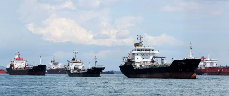 """Oil tankers (L-R) """"Jurong Krapu"""", """"Hai Soon X"""" and """"TMN Pioneer"""" are seen off southern Singapore April 18, 2012.  REUTERS/Tim Chong"""
