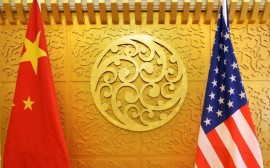 FILE PHOTO: Chinese and U.S. flags are set up for a meeting during a visit by U.S. Secretary of Transportation Elaine Chao at China's Ministry of Transport in Beijing, China April 27, 2018. REUTERS/Jason Lee