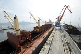 A cargo ship is loaded with coal during the opening ceremony of a new dock at the North Korean port of Rajin in this July 18, 2014 file photo. South Korea said on March 8, 2016 it would impose new sanctions against 40 individuals and 30 entities because of suspected links to North Korea's weapons programme and would ban vessels that had stopped at North Korean ports in the past 180 days.  REUTERS/Yuri Maltsev/Files