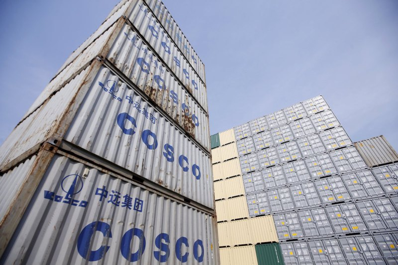 """Containers from China Ocean Shipping Company (COSCO) are pictured at a port in Shanghai, China, in this February 17, 2016 file photo. REUTERS/Aly Song/Files     GLOBAL BUSINESS WEEK AHEAD PACKAGE - SEARCH """"BUSINESS WEEK AHEAD MARCH 28"""" FOR ALL IMAGES"""