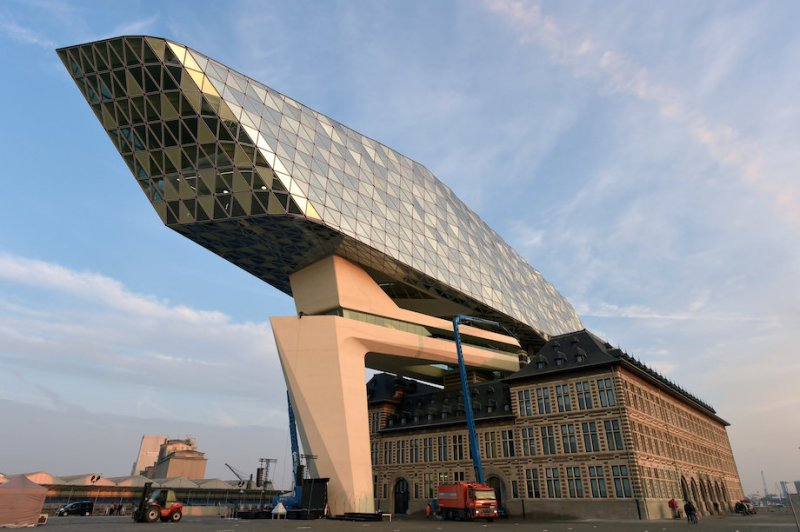 The light of dawn shines on the new headquarters for Antwerp Port Authority on the Kattendijk dock, the Port House, a monumental design by Zaha Hadid Architects in Antwerp, Belgium September 22, 2016. Reuters/Eric Vidal