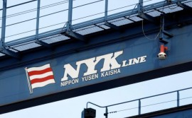 The logo of Japanese shipping company Nippon Yusen (NYK Line) is seen on a container straddle carrier at a dock in Tokyo August 12, 2009.   REUTERS/Stringer/File Photo