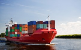 cargo container ship - freighter navigating river