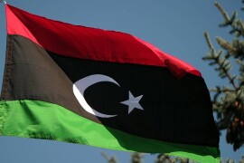 MOSCOW, RUSSIA. AUGUST 29. 2011. The tricoloured flag of Libya's National Transitional Council (NTC) has been hoisted at the Libyan Embassy in Moscow on Monday, August 29, 2011. (Photo ITAR-TASS / Vladimir Astapkovich)  Россия. Москва. 29 августа. Триколор Переходного национального совета над посольством Ливии. Фото ИТАР-ТАСС/ Владимир Астапкович